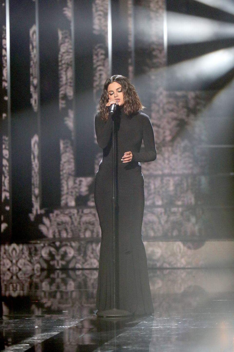 "<p>Beginning her performance during the American Music Awards, where she performed ""Lose You to Love Me"" and ""Look at Her Now.""</p>"