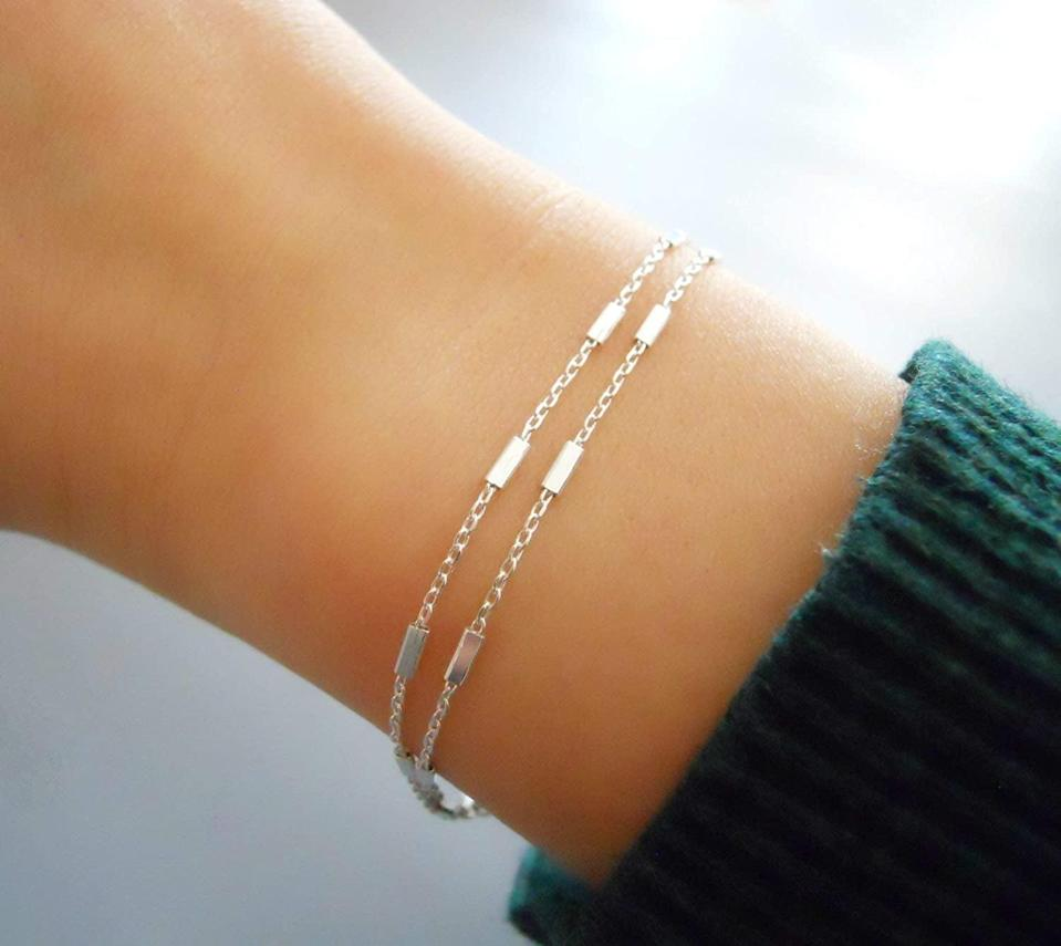 <p>The <span>annikabella Handmade Dainty Double Stranded Sterling Silver Bracelet</span> ($25) is a timeless and dainty piece that's perfect for stacking</p>