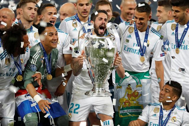 Soccer Football - Champions League Final - Real Madrid v Liverpool - NSC Olympic Stadium, Kiev, Ukraine - May 26, 2018 Real Madrid's Isco lifts the trophy as they celebrate winning the Champions League REUTERS/Andrew Boyers
