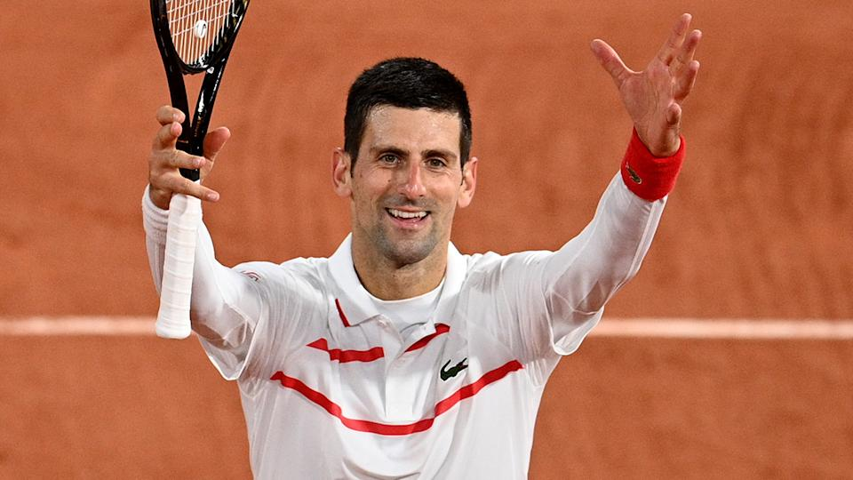 Novak Djokovic is pictured celebrating after winning against Colombia's Daniel Elahi Galan at the French Open. (Photo by ANNE-CHRISTINE POUJOULAT/AFP via Getty Images)
