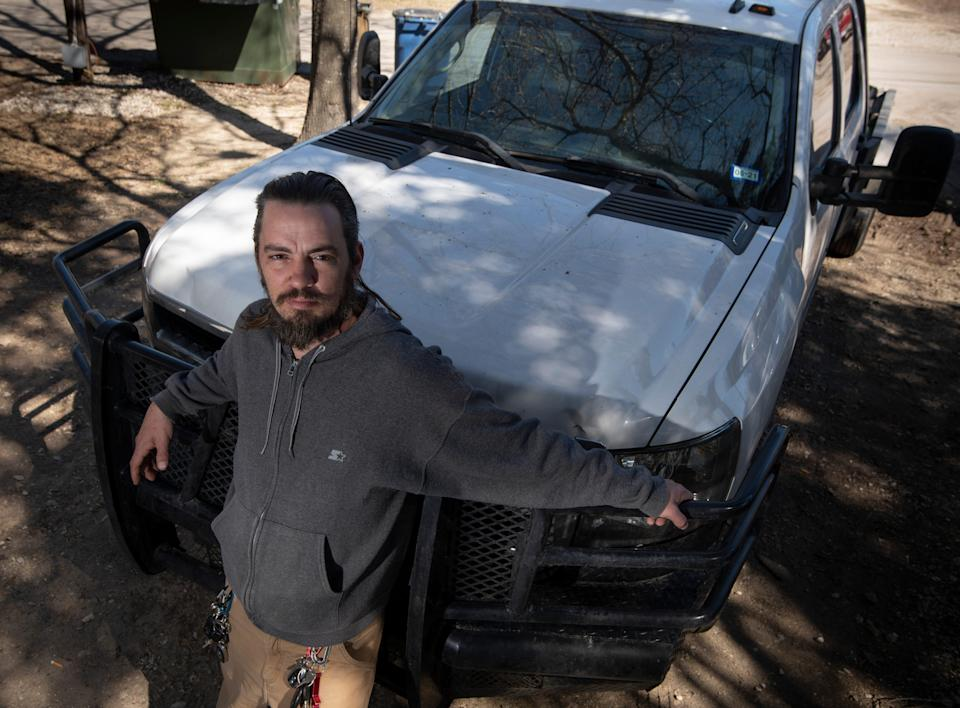 Ryan Sivley poses for a portrait with his 2010 Chevrolet Silverado Tuesday, Feb. 23, 2021 in Austin, Texas. Sivley used his truck and a 4x4 SUV to help 500 stranded motorists during February's winter storm that brought freezing temperatures, sleet and snow.