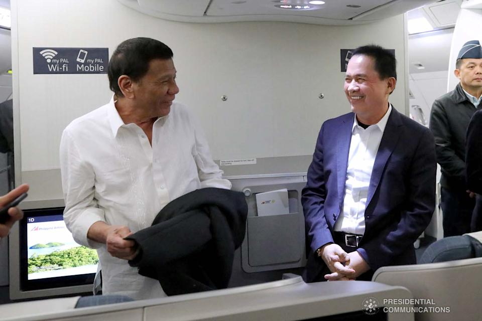 President Rodrigo Roa Duterte shares a light moment with the Kingdom of Jesus Christ, The Name Above Every Name Founder and Executive Pastor Apollo Quiboloy while on board a plane bound for Davao City on October 5, 2019. PCOO/King Rodriguez
