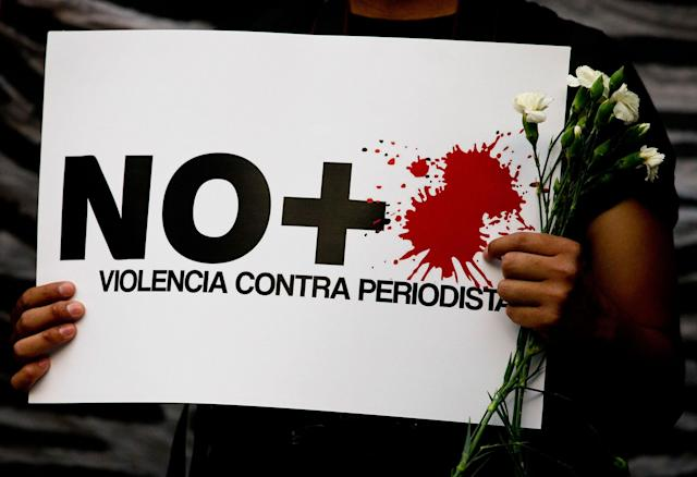 """<p>A protestor holds a sign reading """"No more violence against journalists,"""" during a demonstration outside the Interior Ministry in Mexico City, Tuesday, May 16, 2017. (AP Photo/Rebecca Blackwell) </p>"""
