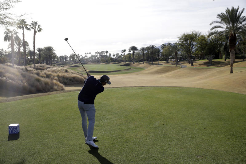 Rickie Fowler hits from the 10th tee during the second round of the American Express golf tournament on the Nicklaus Tournament Course at PGA West on Friday, Jan. 17, 2020, in La Quinta, Calif. (AP Photo/Marcio Jose Sanchez)
