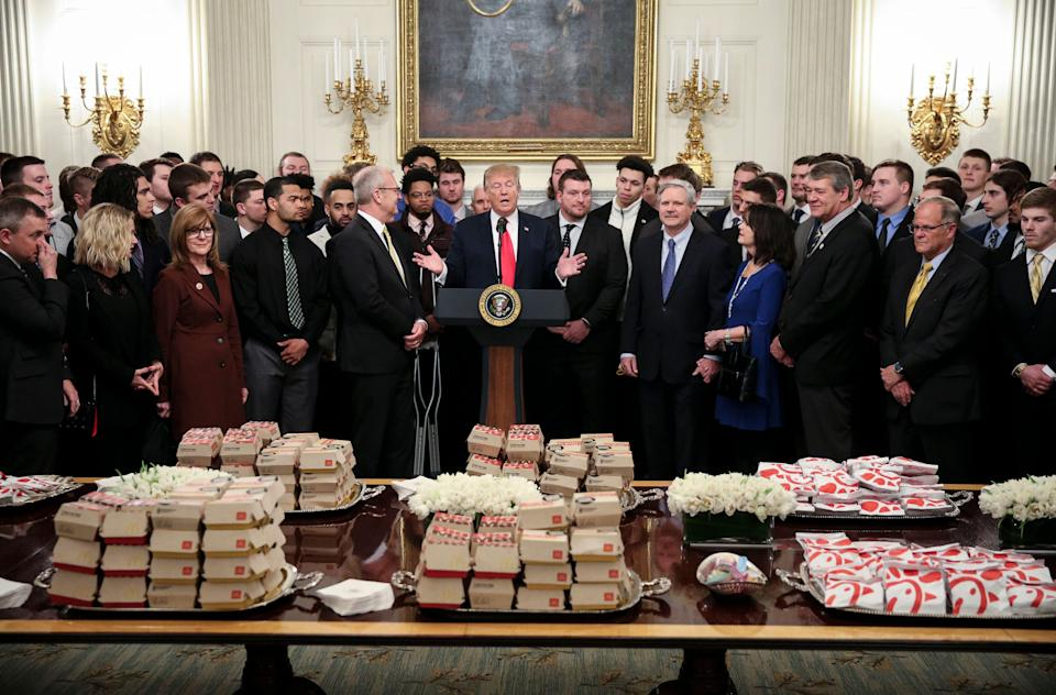 WASHINGTON, DC - MARCH 4:  (AFP OUT)  U.S. President Donald Trump speaks behind a table full of McDonald's hamburgers, Chick fil-a sandwiches and other fast food as he welcomes the 2018 Football Division I FCS champs North Dakota State Bison in the Diplomatic Room of the White House on March 4, 2019 in Washington, DC. (Photo by Oliver Contreras-Pool/Getty Images)