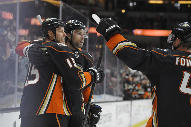 Anaheim Ducks center Ryan Getzlaf, left, celebrates his goal with defensemen Erik Gudbranson, center, and Cam Fowler during the second period of an NHL hockey game against the Washington Capitals on Friday, Dec. 6, 2019, in Anaheim, Calif. (AP Photo/Mark J. Terrill)