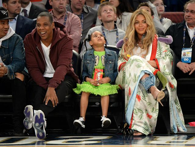 A new survey finds that Beyoncé, pictured here with daughter Blue Ivy and husband Jay-Z, is less popular than Melania Trump. (Photo: Getty Images)