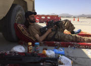 A Taliban fighter takes a rest inside the Hamid Karzai International Airport in Kabul, Afghanistan, Sunday, Sept. 5, 2021. (AP Photo/Mohammad Asif Khan)