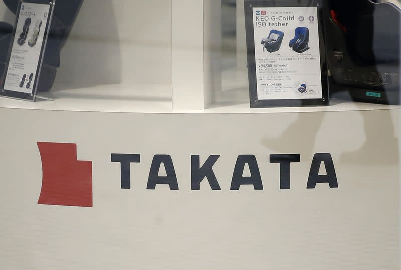 Displays of Takata Corp are pictured at a showroom for vehicles in Tokyo