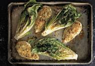 """You throw this in the oven with parmesan and breadcrumbs. 15 minutes later? Dinner. <a href=""""https://www.bonappetit.com/recipe/parmesan-chicken-caesar-roasted-romaine?mbid=synd_yahoo_rss"""" rel=""""nofollow noopener"""" target=""""_blank"""" data-ylk=""""slk:See recipe."""" class=""""link rapid-noclick-resp"""">See recipe.</a>"""