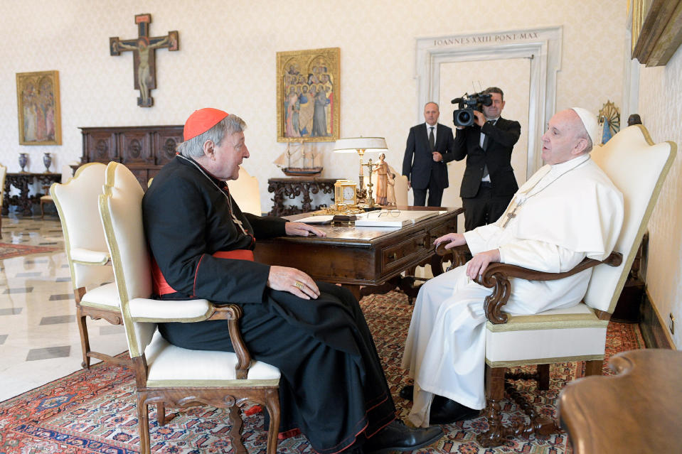 Pope Francis, right, sits at a table with Cardinal George Pell on the occasion of their private meeting at the Vatican, Monday, Oct. 12, 2020. The Pope warmly welcomed Cardinal for a private audience in the Apostolic Palace after the cardinal's sex abuse conviction and acquittal in Australia. (Vatican News via AP)