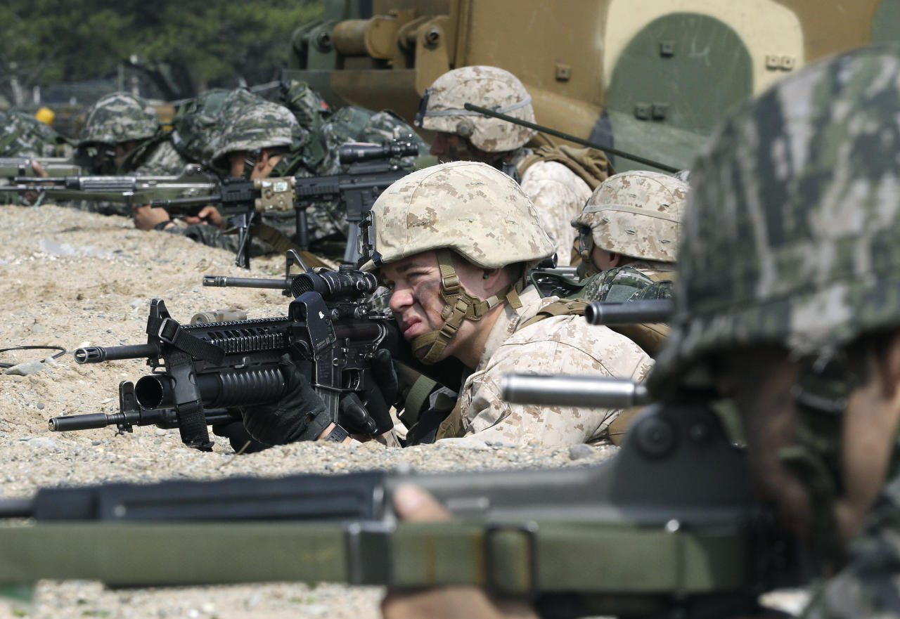 South Korean and U.S. Marines aim their machine gunds during the U.S.-South Korea joint landing exercises called Ssangyong, part of the Foal Eagle military exercises, in Pohang, South Korea, Monday, March 31, 2014. South Korea says North Korea has announced plans to conduct live-fire drills near the rivals' disputed western sea boundary. The planned drills Monday come after an increase in threatening rhetoric from Pyongyang and a series of rocket and ballistic missile launches in an apparent protest against the annual military exercises by Seoul and Washington. (AP Photo/Ahn Young-joon)