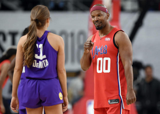 Actor Jamie Foxx banters with with TV personality Rachel DeMita during the NBA All-Star celebrity basketball game in Los Angeles. (AP Photo)