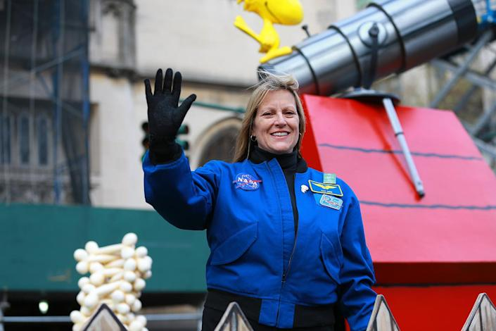 Decorated astronaut Kay Hire waves to crowds on Snoopy's Doghouse from Peanuts Worldwide Float in the 93rd Macy's Thanksgiving Day Parade. (Photo: Gordon Donovan/Yahoo News)