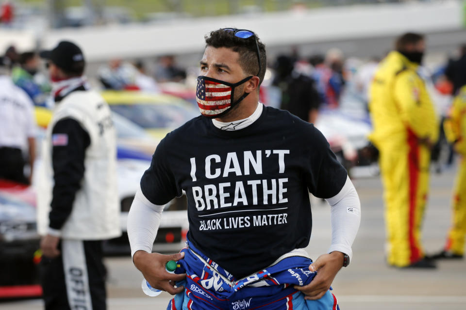 FILE - In this this June 10, 2020, file photo, driver Bubba Wallace wears a Black Lives Matter shirt as he prepares for a NASCAR Cup Series auto race in Martinsville, Va. (AP Photo/Steve Helber, File)