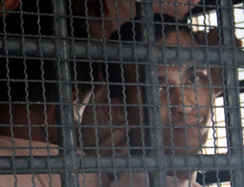 Surasak Suwannachote, right, is transported with other prisoners on a prison van out of Phuket criminal court in Phuket, southern Thailand Wednesday, Aug. 8, 2012. Surasak, 26, and another Thai suspected Surin Tabthong were sentenced to life in prison Wednesday for murdering a 60-year old Australian tourist woman they were trying to rob on one of Thailand's most popular resort islands. (AP Photo)