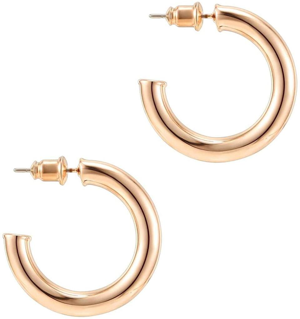 <p>You can wear these <span>Pavoi 14K Rose Gold Hoop Earrings</span> ($14) with any outfit.</p>