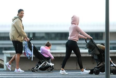 87678175_Cristiano Ronaldo L and his partner Georgina Rodriguez push two strollers as they have.jpg