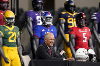 Texas Tech head coach Matt Wells smiles as he looks out from the stage during the NCAA college football Big 12 media days Thursday, July 15, 2021, in Arlington, Texas. (AP Photo/LM Otero)