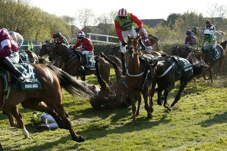 Britain Horse Racing - Grand National Festival - Aintree Racecourse - 8/4/17 Sam Waley-Cohen falls off the The Young Master during the 5:15 Randox Health Grand National Action Images via Reuters / Andrew Boyers Livepic