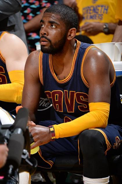 OAKLAND, CA - JUNE 4: Kyrie Irving #2 of the Cleveland Cavaliers sits on the bench during a time-out during Game One of the 2015 NBA Finals on June 4, 2015 at Oracle Arena in Oakland, California. (Photo by Andrew D. Bernstein/NBAE via Getty Images)