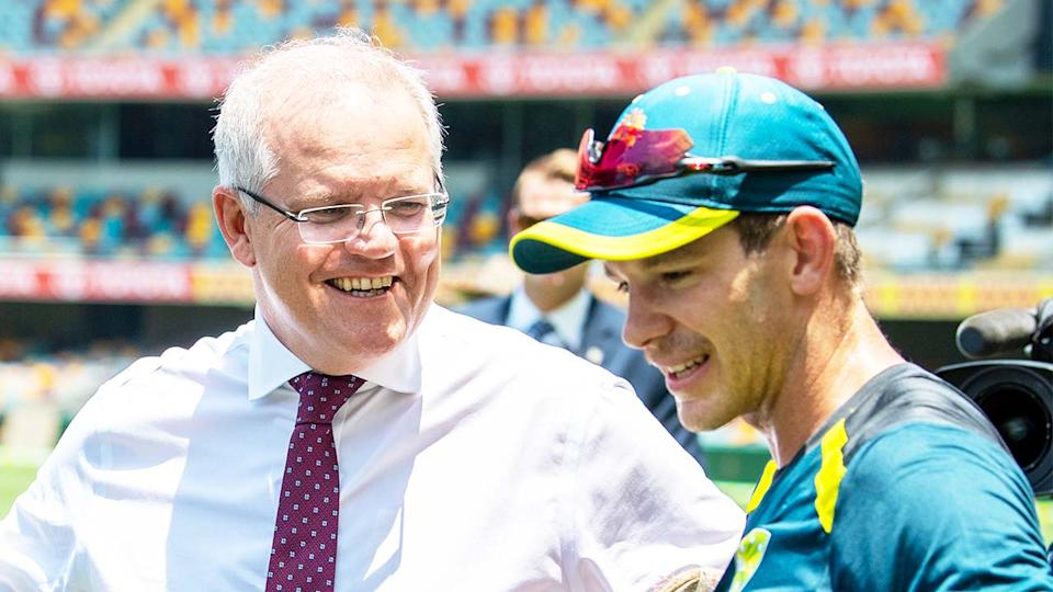 Tim Paine (pictured right) revealed Prime Minister Scott Morrison (pictured left) messaged him about the ongoing Ashes negotiations with England. (Getty Images)