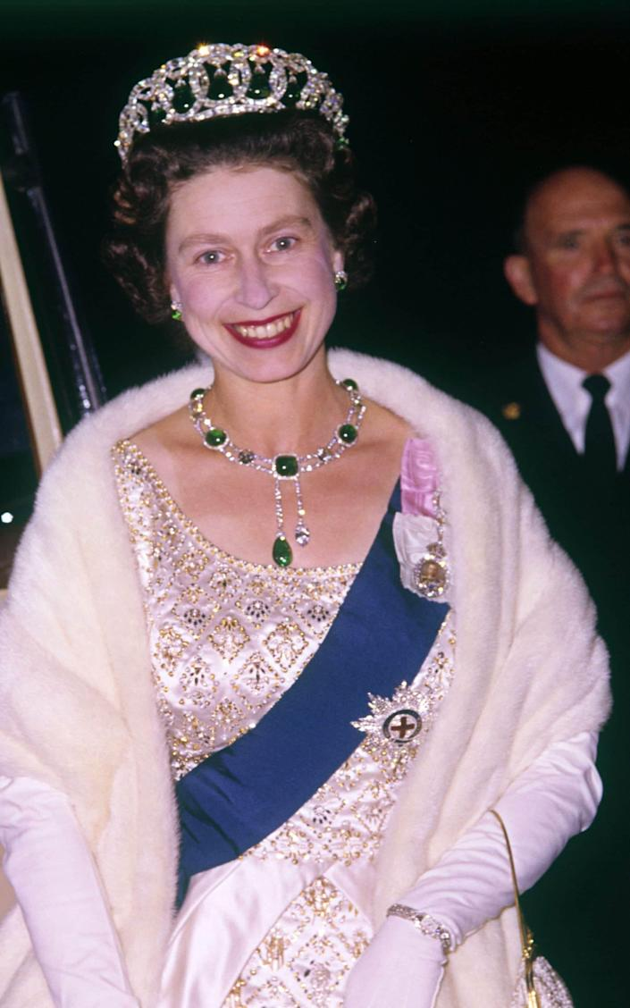 The Queen wearing The Cambridge emeralds - Rex Features
