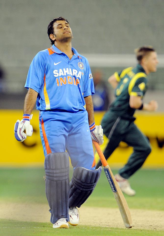 Indian batsman MS Dhoni reacts after teammate Ravichandran Ashwin was run out by Australia in their international one day cricket match at the Melbourne Cricket Ground (MCG), on   February 5, 2012.