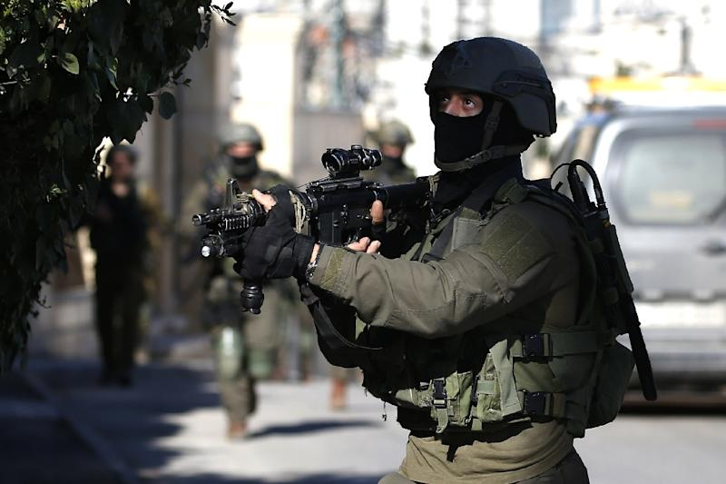 Israeli troops thrust deep inside the Palestinian-controlled West Bank city of Ramallah to carry out the demolition which triggered clashes with angry residents ordered out of their homes in the cold of night (AFP Photo/ABBAS MOMANI)