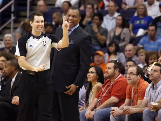 Phoenix Suns coach Alvin Gentry, right, laughs as official Brian Forte, left, calls a technical foul against the Washington Wizards in the first quarter of an NBA basketball game Monday, Feb. 20, 2012, in Phoenix. (AP Photo/Paul Connors)