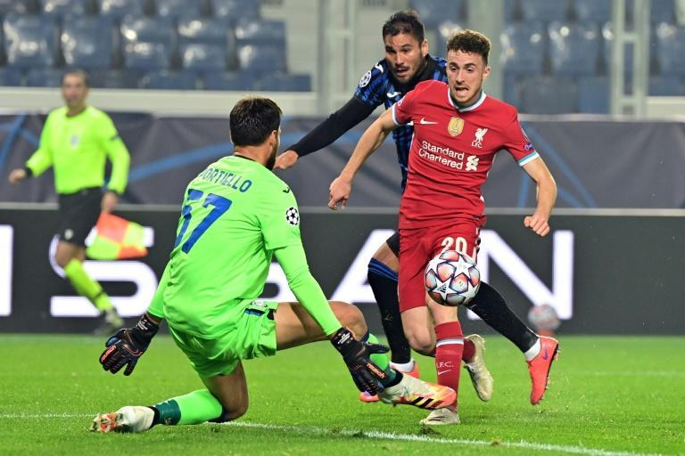 Diogo Jota finishes past Atalanta goalkeeper Marco Sportiello on his way to a hat-trick in Liverpool's 5-0 Champions League win on Tuesday