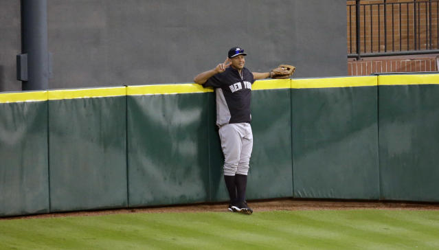 New York Yankees' Alex Rodriguez holds up two fingers as he stands on Tal's Hill in center field before a baseball game against the Houston Astros Saturday, Sept. 28, 2013, in Houston. (AP Photo/David J. Phillip)