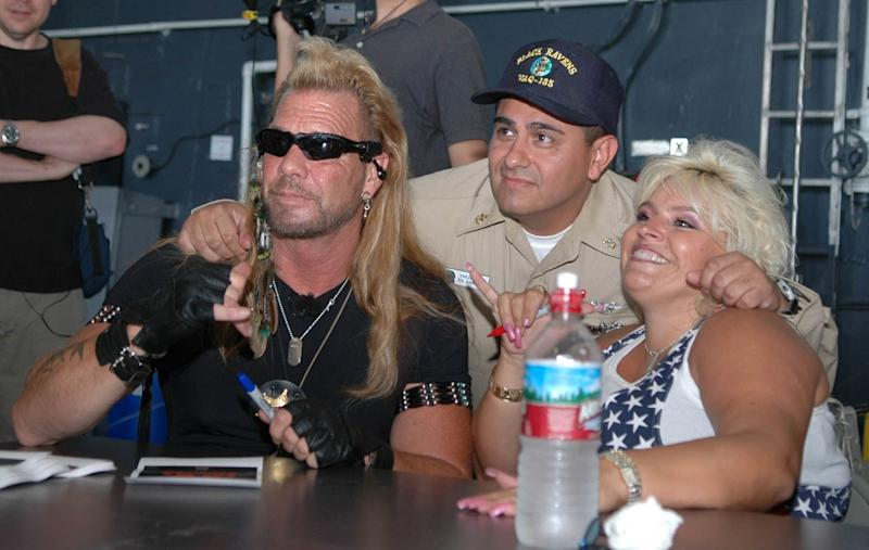 Duane Chapman in a group photo with his late wife, Beth Smith and another man, and they are smiling beautifully.
