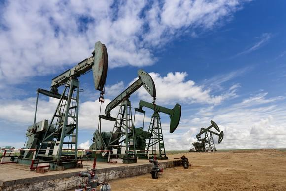 Several oil pumps in a field.