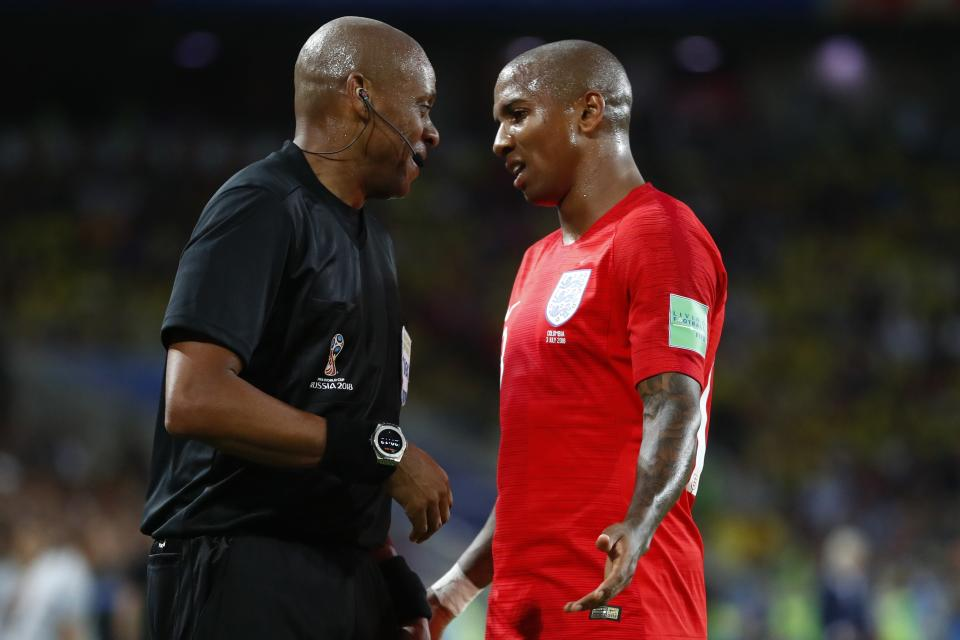 <p>Ashley Young speaks with the assistant referee after some physical contact between Harry Maguire and Juan Cuadrado </p>