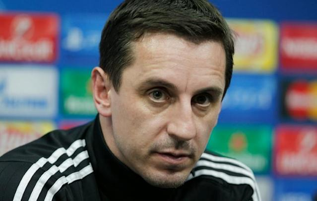 Valencia's coach Gary Neville looks on during a press conference at the Valencia's Sport City in Valencia on December 8, 2015, on the eve of the UEFA Champions League match Valencia CF vs Lyon