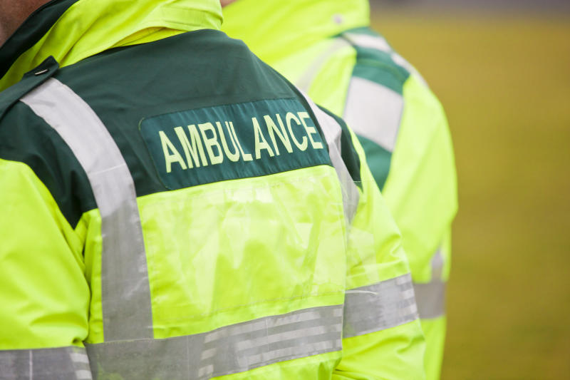 """""""Two UK Ambulance paramedics in attendance at an outdoor event. Copy space,"""""""