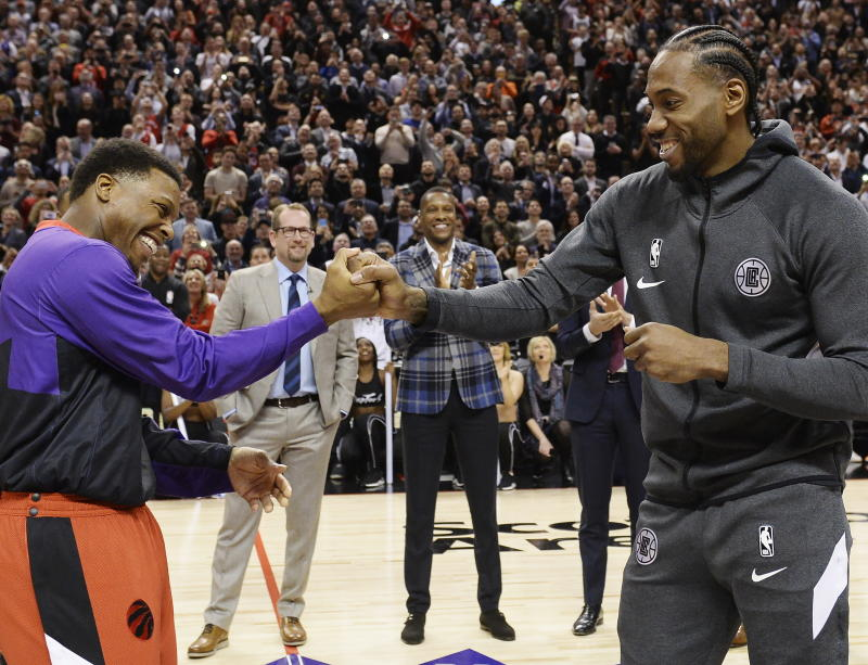 Kyle Lowry and an appreciative Raptors crowd gave Kawhi Leonard a warm welcome in his return to Toronto. (Nathan Denette/The Canadian Press via AP)