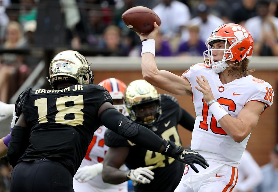 Wake Forest pass rusher Carlos Basham Jr. (18) took down Trevor Lawrence for a sack this season. (Photo by Streeter Lecka/Getty Images)