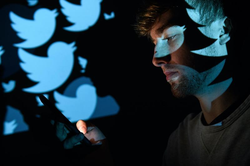 In this photo illustration, the logo for the Twitter social media network is projected onto a man on August 09, 2017 in London, England: Leon Neal/Getty Images