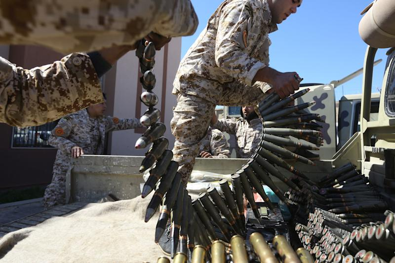Fighters from a Misrata armed group loyal to the internationally recognised Libyan Government of National Accord (GNA) prepare their ammunition before heading to the frontline as battles against Forces of Libyan strongman Khalifa Haftar continue on the outskirts of the capital Tripoli on April 8, 2019. - At least 32 people have been reported killed and around 50 wounded in fighting with Haftar's troops near Tripoli, the UN-backed government said. Fierce clashes raged yesterday near the capital between pro-Haftar fighters and troops loyal to the internationally recognised Government of National Accord (GNA). (Photo by Mahmud TURKIA / AFP) (Photo credit should read MAHMUD TURKIA/AFP/Getty Images)
