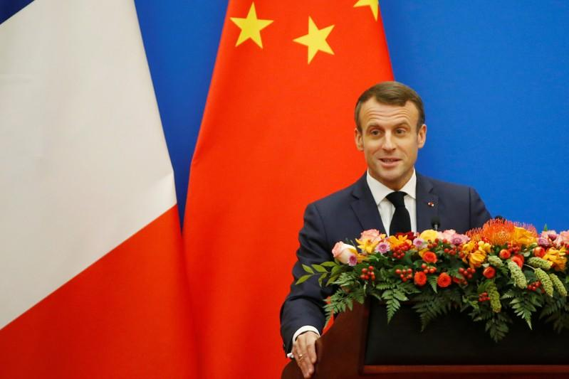 French President Emmanuel Macron speaks at a China-France Economic Forum at the Great Hall of the People in Beijing