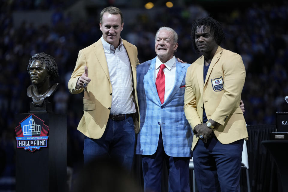 Former Indianapolis Colts players Peyton Manning and Edgerrin James stand with Indianapolis Colts owner Jim Irsay after Manning and James received their Pro Football Hall of Fame commemorative rings during an NFL football game, Sunday, Sept. 19, 2021, in Indianapolis. (AP Photo/AJ Mast)