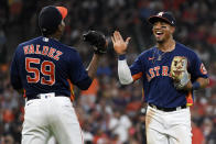 Houston Astros third baseman Robel Garcia, right, celebrates with starting pitcher Framber Valdez after throwing out Chicago White Sox's Adam Engel to end the top of the fifth inning of a baseball game, Saturday, June 19, 2021, in Houston. (AP Photo/Eric Christian Smith)