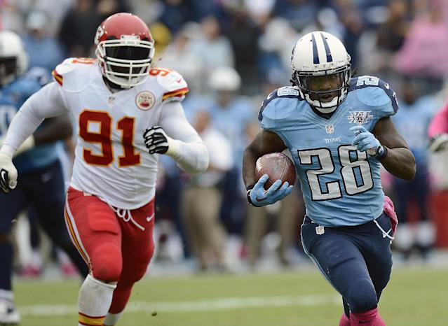 Tennessee Titans running back Chris Johnson (28) scores a touchdown on a 49-yard pass play as Kansas City Chiefs linebacker Tamba Hali (91) pursues in the third quarter of an NFL football game on Sunday, Oct. 6, 2013, in Nashville, Tenn. (AP Photo/Mark Zaleski)