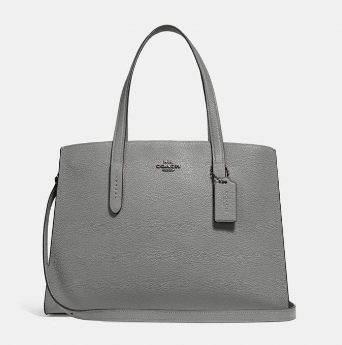 The Charlie Carryall is so popular, it comes in size different gorgeous colors. (Photo: Coach)