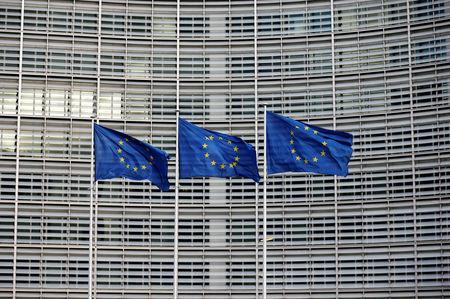 EU flags flutter outside the EU Commission headquarters in Brussels