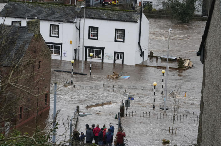 A view of a flooded street in Appleby-in-Westmorland, as Storm Ciara hits the UK, in Cumbria, England, Sunday Feb. 9, 2020. Trains, flights and ferries have been cancelled and weather warnings issued across the United Kingdom as a storm with hurricane-force winds up to 80 mph (129 kph) batters the region. (Owen Humphreys/PA via AP)
