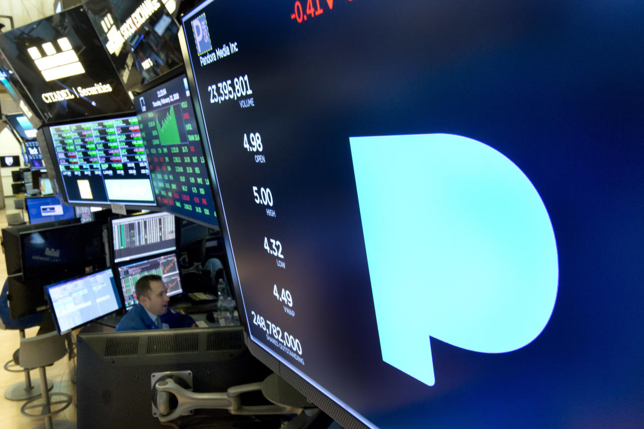 <p> FILE - In this Feb. 22, 2018, file photo, the Pandora logo appears above a trading post on the floor of the New York Stock Exchange. Subscription radio company SiriusXM says it's buying music streaming service Pandora Media Inc. in a stock deal valued at about $3.5 billion that'll allow it to expand its service beyond cars and into homes and other mobile areas. (AP Photo/Richard Drew, File) </p>