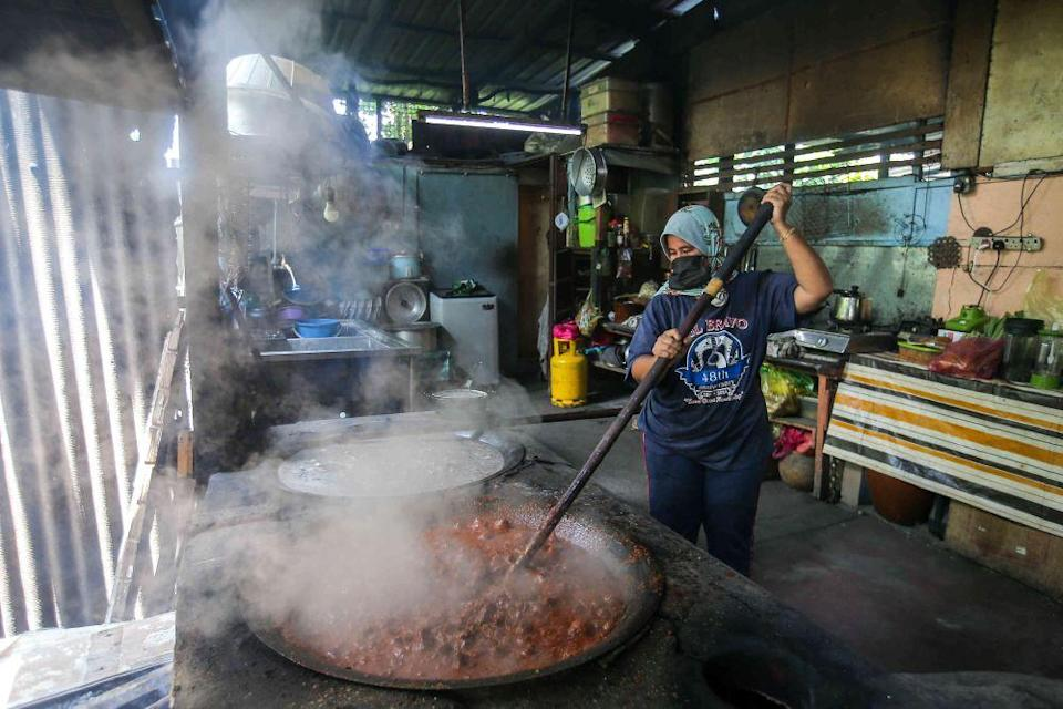 Caterer Noor Huda Mat Isa makes two pots of her Rendang Tok Perak daily during Ramadan to cater to demand. — Picture by Farhan Najib
